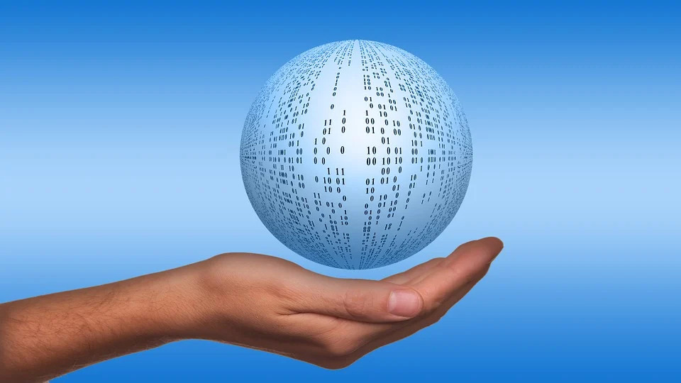 image of a ball covered in binary data floating over open hand