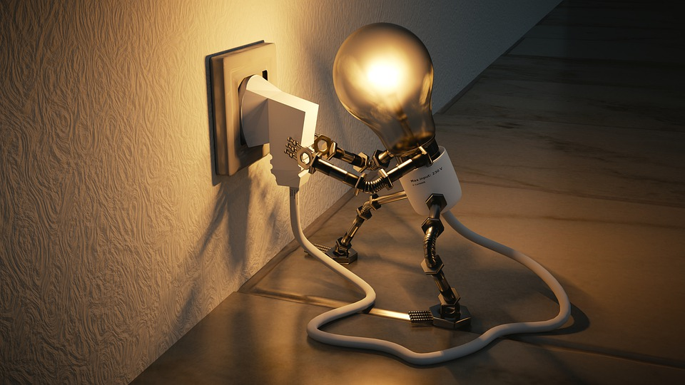 image of lightbulb figure plugging itself in