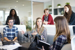 management group discussing labor productivity