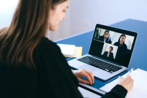 woman on video call in front of laptop
