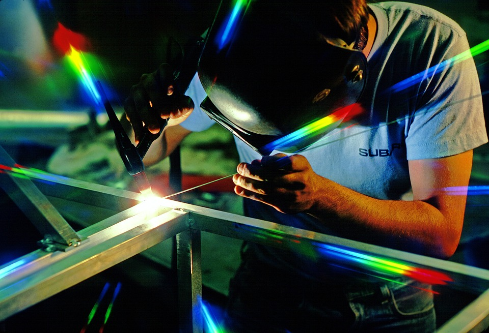 manufacturing industry worker welding components